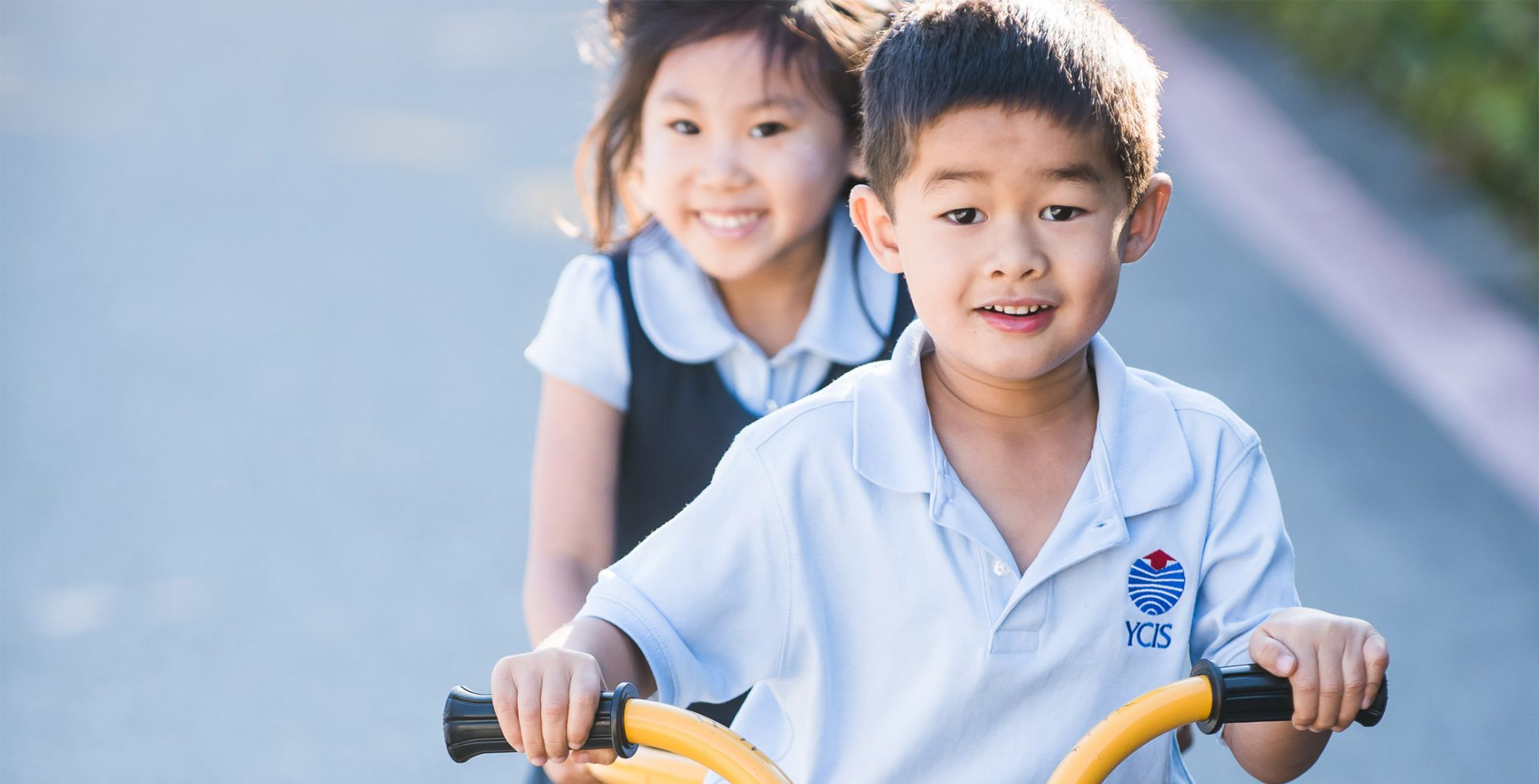 boy and a girl riding a bicycle